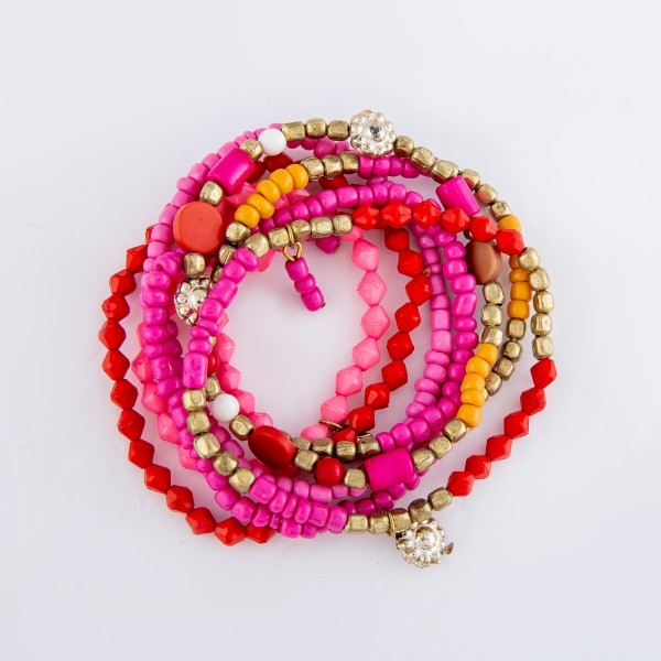 "Fuchsia Beaded Boho Flower Charm Stretch Bracelet Set.  - 7pcs/set - Approximately 3"" in diameter - Fits up to a 7"" wrist"