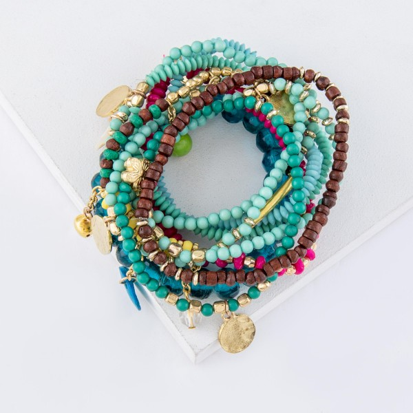 "Teal Green Multi Beaded Boho Jingle Coin Charm Stacking Stretch Bracelet Set.  - 10pcs/set - Approximately 3"" in diameter unstretched - Fits up to a 7"" wrist"