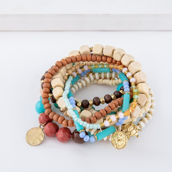 "Natural Blue Wooden Beaded Boho Sea Charm Stacking Stretch Bracelet Set.  - 10pcs/set - Approximately 3"" in diameter unstretched - Fits up to a 7"" wrist"