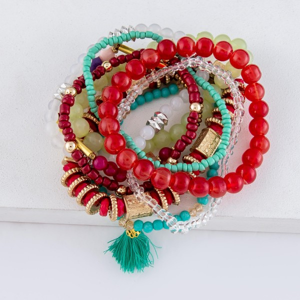 "Red Multi Semi Precious Beaded Tassel Stacking Stretch Bracelet Set.  - 9pcs/set - Approximately 3"" in diameter - Fits up to a 7"" wrist"