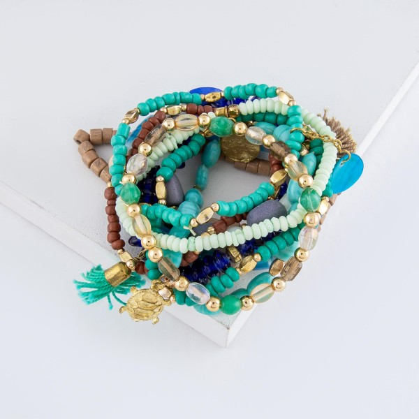 "Royal Mint Semi Precious Heishi Beaded Sea Turtle Charm Tassel Stacking Stretch Bracelet Set with Shell Detail.  - 10pcs/set - Approximately 3"" in diameter - Fits up to a 7"" wrist"