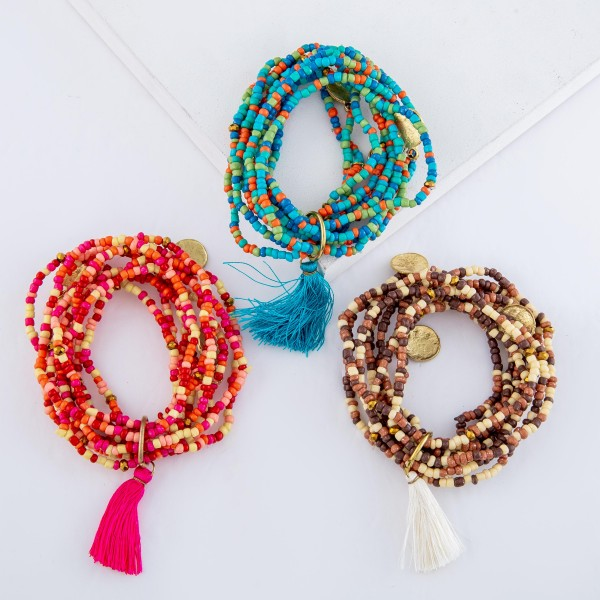 "Natural Multi Seed Beaded Coin Tassel Stacking Stretch Bracelet Set.  - 10pcs/set - Approximately 3"" in diameter  - Fits up to a 7"" wrist"