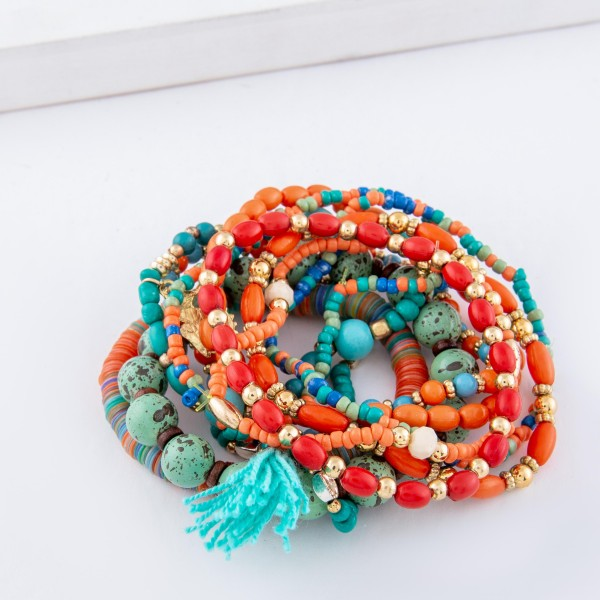 "Turquoise Multi Semi Precious Sequin Beaded Boho Sea Charm Tassel Stacking Stretch Bracelet Set.  - 11pcs/set - Approximately 3"" in diameter unstretched - Fits up to a 7"" wrist"