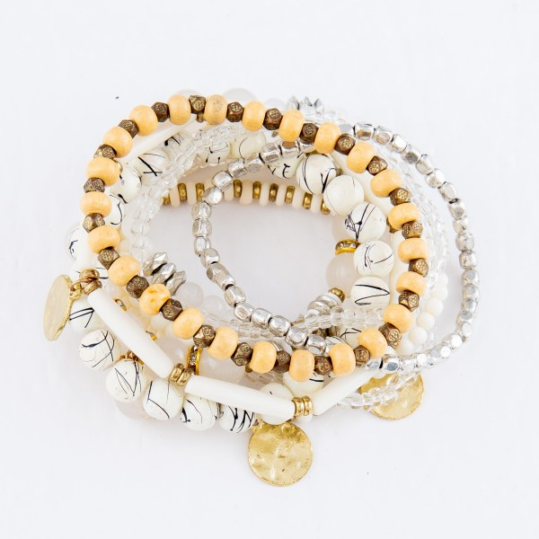 """Ivory Beaded Boho Stackable Bracelet Set in Gold and Silver.  - 10pcs per pack - Approximately 3"""" in Diameter - Fits up to a 7"""" Wrist"""