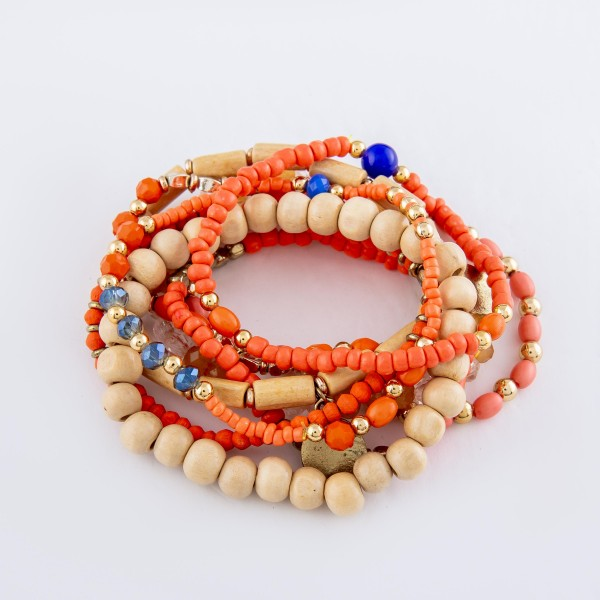 "Peach Wood Beaded Boho Coin Charm Stacking Stretch Bracelet Set.  - 10pcs/set - Approximately 3"" in diameter - Fits up to a 7"" wrist"