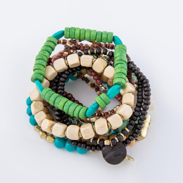 "Multi Wooden Beaded Heishi Boho Tassel Stacking Stretch Bracelet Set.  - 11pcs/set - Approximately 3"" in diameter unstretched - Fits up to a 7"" wrist"