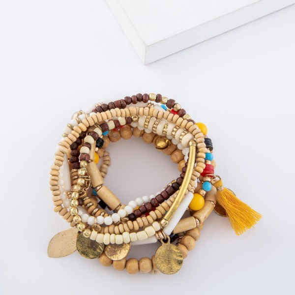 "Natural Multi Wooden Beaded Boho Coin Tassel Stretch Bracelet Set.  - 10pcs/set - Approximately 3"" in diameter unstretched - Fits up to a 7"" wrist"