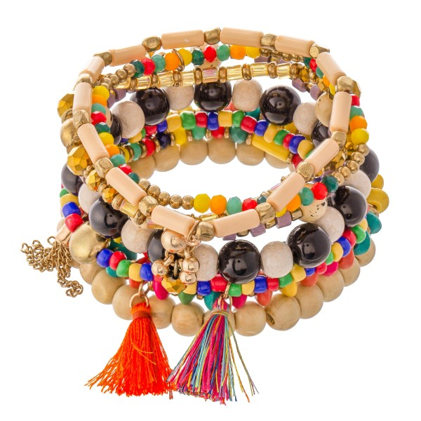 "Set of 9 beaded bracelets featuring tassel accents and metal details.  - Approximately 3"" in diameter unstretched - Fits up to a 6"" wrist"