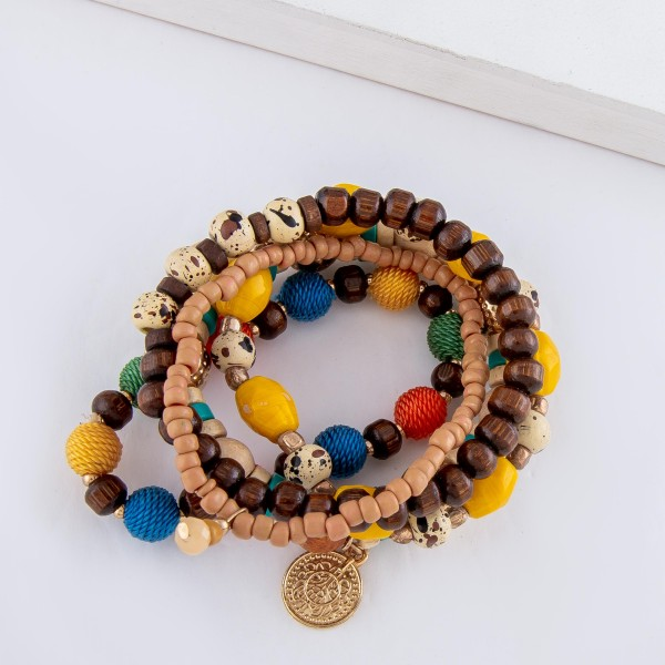"Multicolor Heishi Wood Beaded Thread Wrapped Ball Stacking Stretch Bracelet Set.  - 5pcs/set - Approximately 3"" in diameter - Fits up to a 7"" wrist"