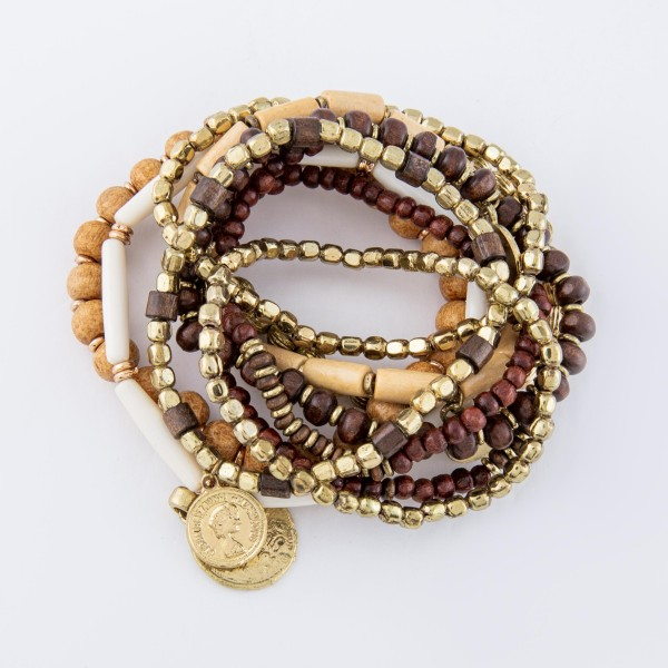 "Natural Brown Wooden Beaded Boho Coin Stacking Stretch Bracelet.  - 10pcs/set - Approximately 3"" in diameter unstretched - Fits up to a 7"" wrist"