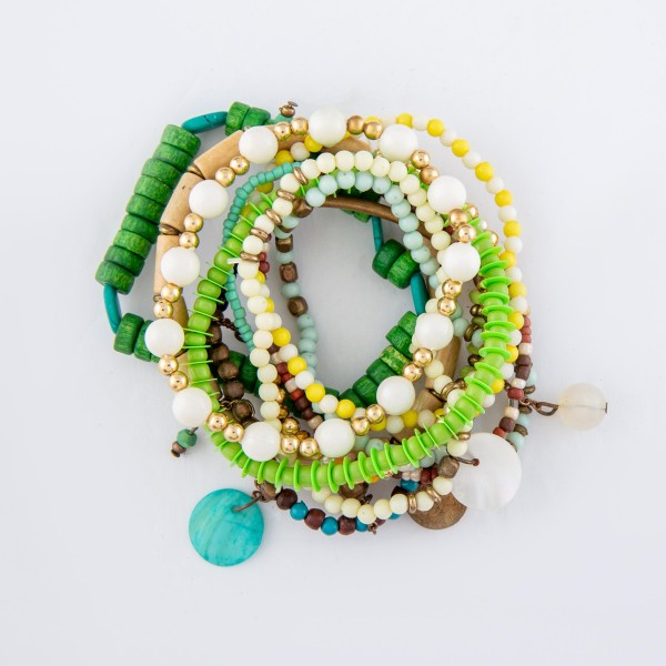 "Green Wooden Heishi Beaded Boho Jingle Charm Stacking Stretch Bracelet Set.  - 10pcs/set - Approximately 3"" in diameter unstretched - Fits up to a 7"" wrist"