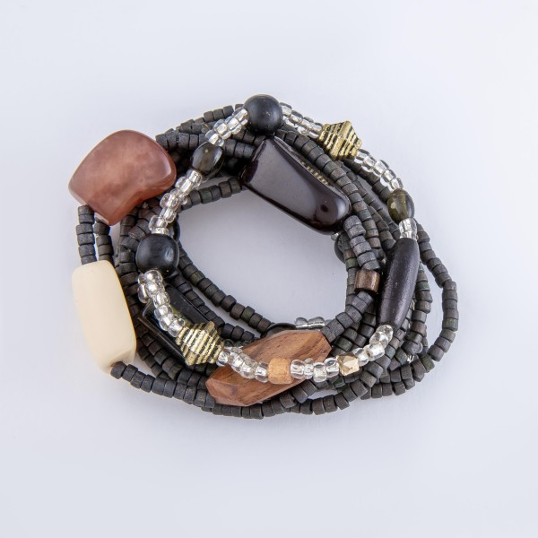 "Hematite Tone Rondelle Beaded Stacking Stretch Bracelet Set with Resin, Wood and Glass Statement Bead Details.  - 10pcs/set - 2.5mm Bead Size - Approximately 3"" in diameter - Fits up to a 7"" wrist"