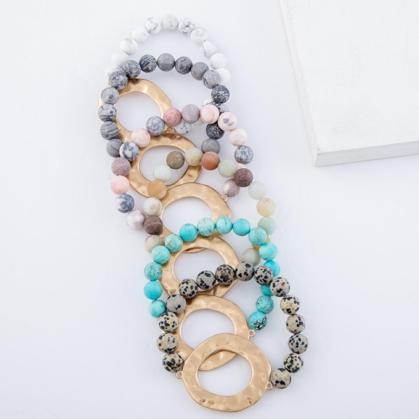 "Semi Precious Natural Stone Beaded Stretch Bracelet with Gold Hammered Focal.  - Focal 1.5"" in diameter - Approximately 3"" in diameter unstretched  - Fits up to a 7"" wrist"