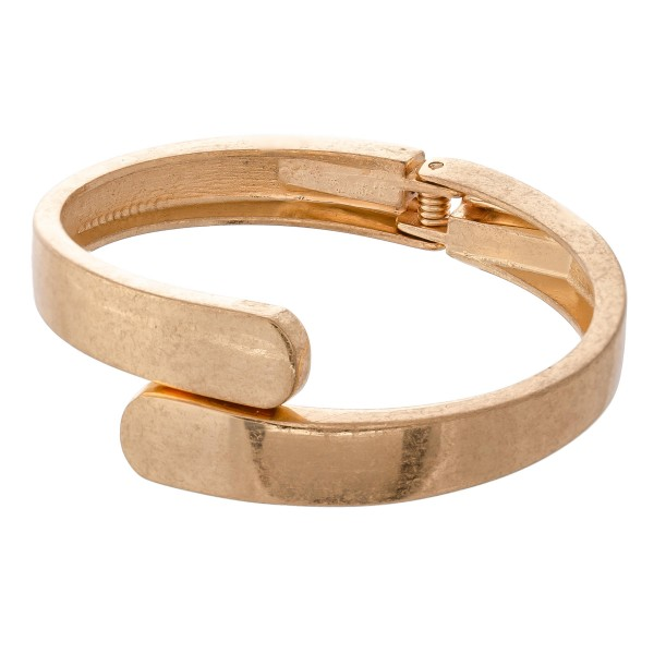 "Overlap Hinge Bangle in Worn Gold.  - Approximately 2.5"" in diameter - Fits up to a 5"" wrist"