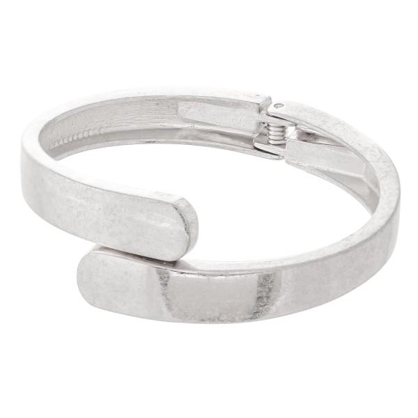 "Overlap Hinge Bangle in Worn Silver.  - Approximately 2.5"" in diameter - Fits up to a 5"" wrist"