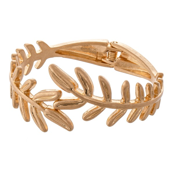"Metal Leaf Hinge Bangle Bracelet in Worn Gold.  - Approximately 2.5"" in diameter - Fits up to a 5"" wrist"