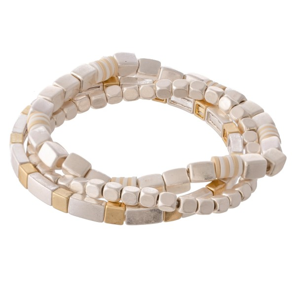 "Two Tone Metal Beaded Stretch Bracelet Set with Spacer Bead Details.  - 3pcs/set - Approximately 3"" in diameter - Fits up to a 7"" wrist"