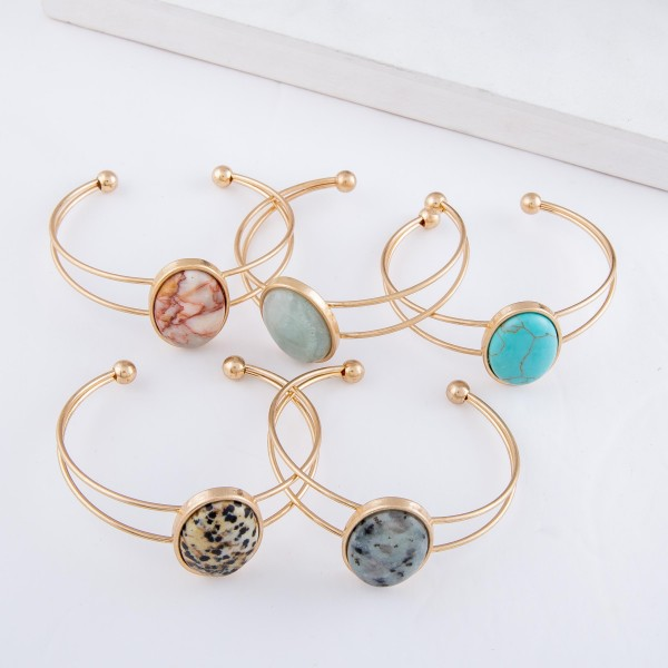 """Natural Stone Cuff Bracelet in Worn Gold.  - Focal approx. 1""""  - Approximately 2.25"""" in diameter - Fits up to a 5"""" wrist"""