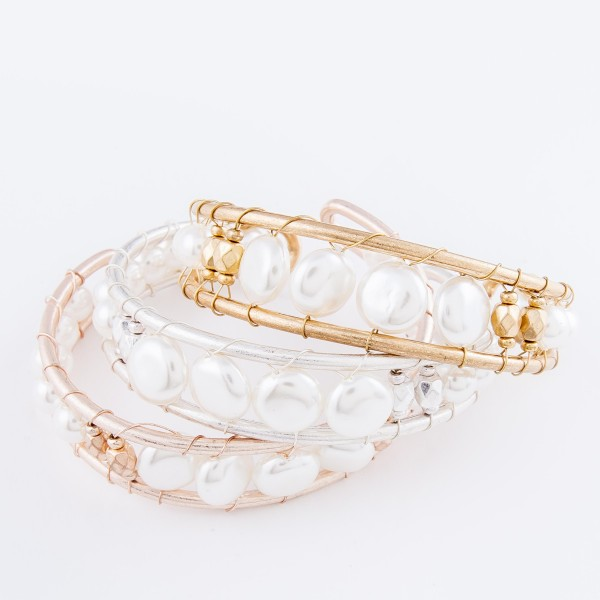 "Ivory Pearl Wire Wrapped Cuff Bracelet in Worn Gold.  - Approximately 2.5"" in diameter - Fits up to a 5"" wrist"
