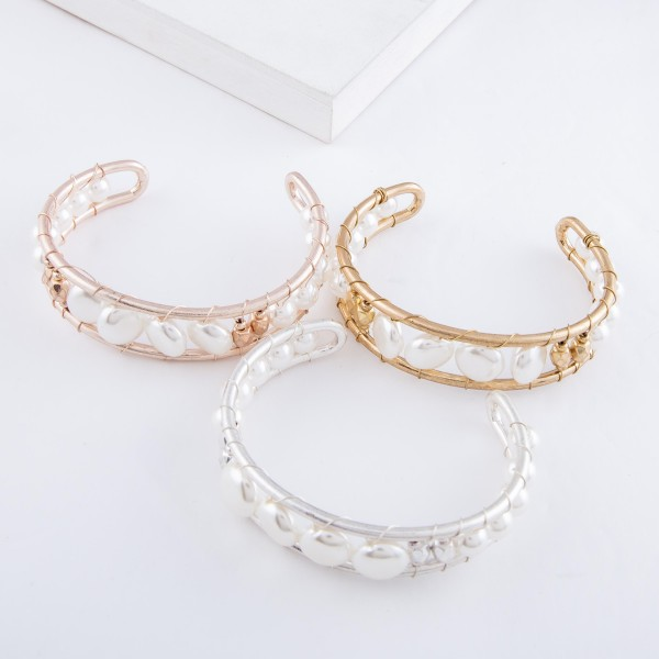 """Ivory Pearl Wire Wrapped Cuff Bracelet in Worn Rose Gold.  - Approximately 2.5"""" in diameter - Fits up to a 5"""" wrist"""