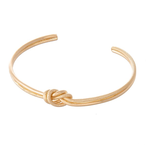 "Brass Love Knot Cuff Bracelet Featuring Textured Details.  - Approximately 2.5"" in Diameter - Fits up to a 5"" wrist"