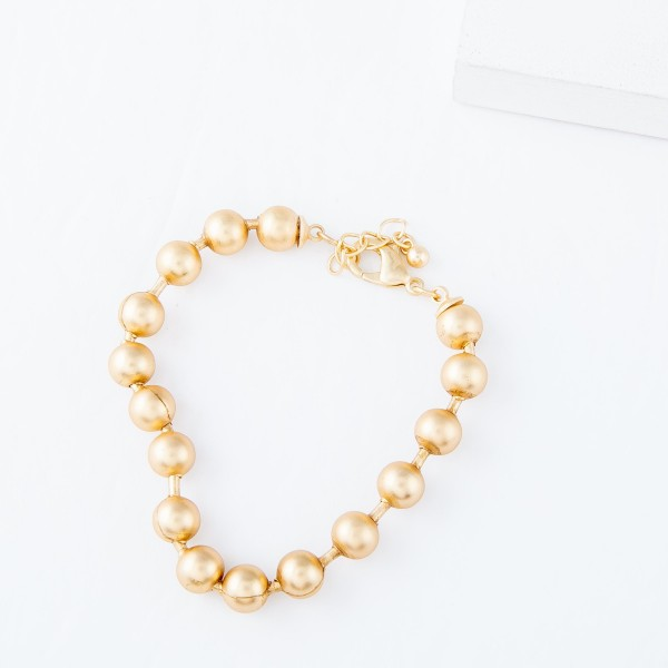 "7mm Ball Chain Bracelet in Worn Gold.  - Approximately 2.5"" in diameter - Fits up to a 6"" wrist - 1"" Adjustable Extender"