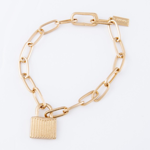 "Chain Link Lock Charm Bracelet in Worn Gold.  - Lock Charm .75"" - Approximately 3"" in diameter - Fits up to a 6"" wrist"