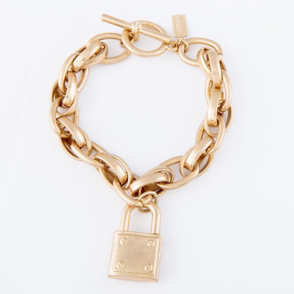 """Chunky Chain Link Lock Charm Statement Bracelet in Worn Gold.  - Lock Charm 1"""" - Toggle Bar Clasp Closure - Approximately 3"""" in diameter - Fits up to a 6"""" wrist"""