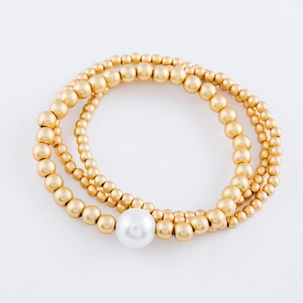 "Beaded Pearl Stretch Bracelet Set in Matte Gold.  - 3pcs/set - 11mm Pearl  - Approximately 3"" in diameter - Fits up to a 7"" wrist"