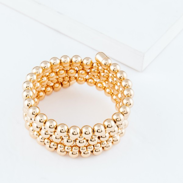 """7mm Pisa Wrap Cuff Bracelet in Gold.  - Approximately 2.5"""" in diameter - Fits up to a 7"""" wrist"""