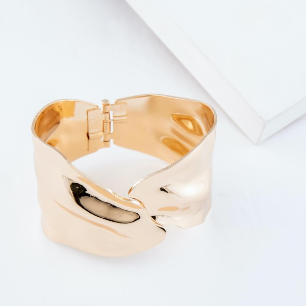 """Hinge Cuff Bracelet in Gold.  - Approximately 2.5"""" in diameter - Fits up to a 5"""" wrist"""