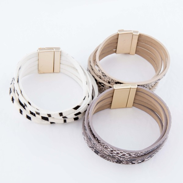 "Multi Strand Faux Leather Zebra Print Cow Hide Magnetic Bracelet.  - Multi-Strand - Magnetic Closure - Approximately 3"" in diameter - Fits up to a 6"" wrist"