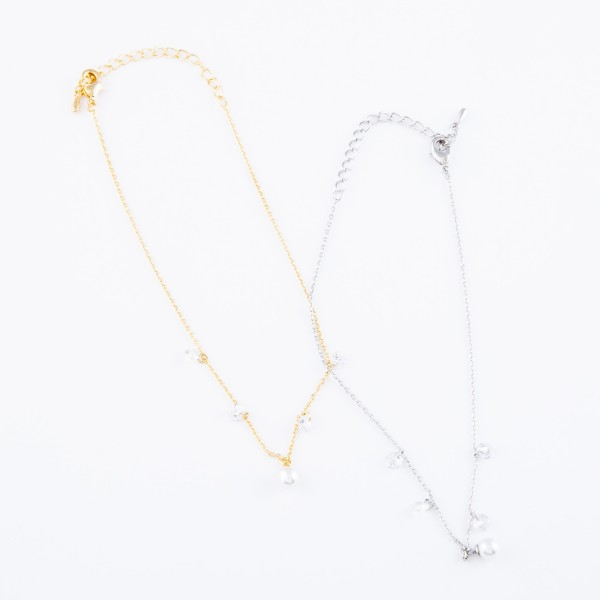 """Dainty Chain Anklet Featuring Pearl & Clear Rhinestone Accents.  - Approximately 4"""" in diameter - Adjustable 2"""" Extender - Fits up to an 8"""" ankle"""