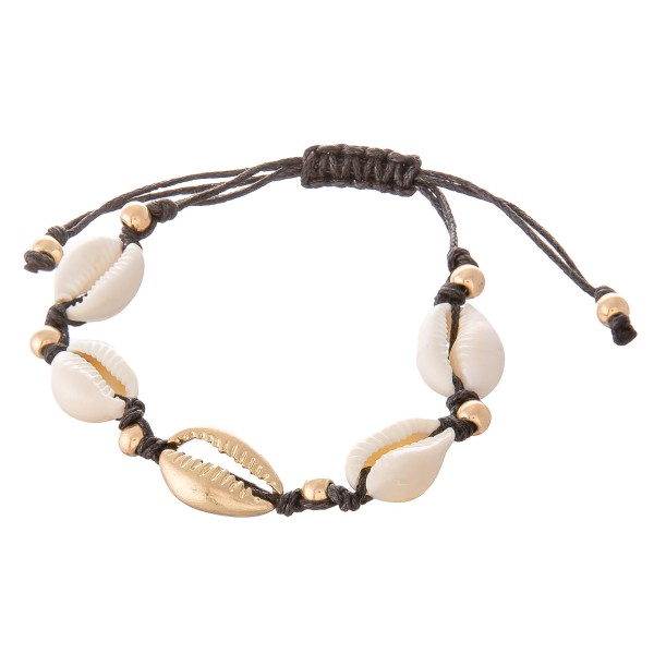 "Puka Shell Cord Bolo Bracelet.  - Approximately 3"" in diameter - Fits up to an 8"" wrist"