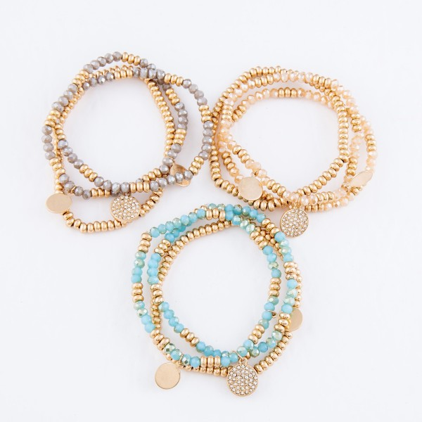 """Beaded Stretch Bracelet Set Featuring Rhinestone Gold Charms.  - 3pcs per set - Approximately 3"""" in diameter - Fits up to a 7"""" wrist"""