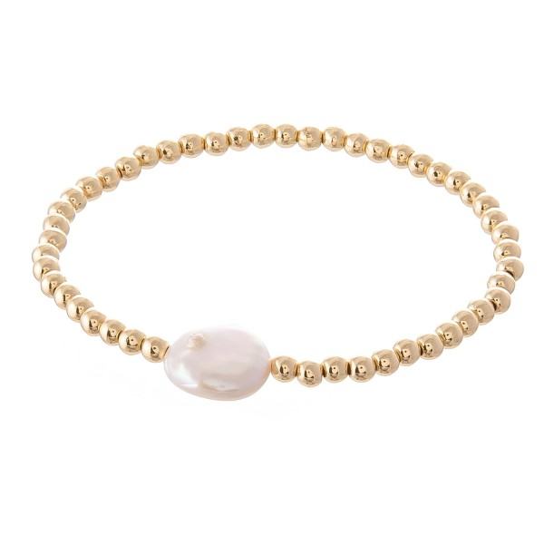 """Gold Beaded Pearl Stretch Bracelet.  - Bead Size: 2mm - Pearl .5""""  - Approximately 3"""" in Diameter  - Fits up to a 7"""" Wrist"""