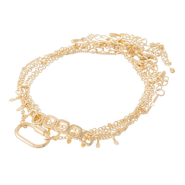 """Multi-Strand Carabiner Chain Link Bracelet Set in Gold.   - 5 Piece Per Set - Can be Worn as Singles or Set - Approximately 3"""" in Diameter - 2"""" Adjustable Extender - Fits up to an 8"""" Wrist"""