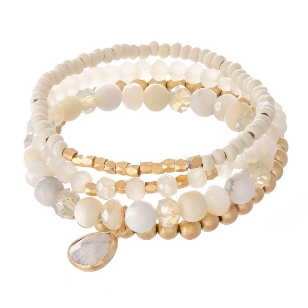 """Semi Precious Beaded Natural Stone Charm Stretch Bracelet Set.  - 4pcs per set - Approximately 3"""" in diameter - Fits up to a 7"""" wrist"""