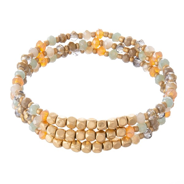 "Multicolor Faceted Beaded Stretch Bracelet Set in Gold.  - 3pcs per set - Approximately 3"" in Diameter - Fits up to a 7"" Wrist - 2mm Bead Size"