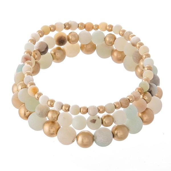 "Natural Stone Beaded Stretch Bracelet Set in Gold.  - 3pcs per set - Approximately 3"" in Diameter  - Fits up to a 7"" Wrist - Bead Size: 2mm, 6mm & 8mm"