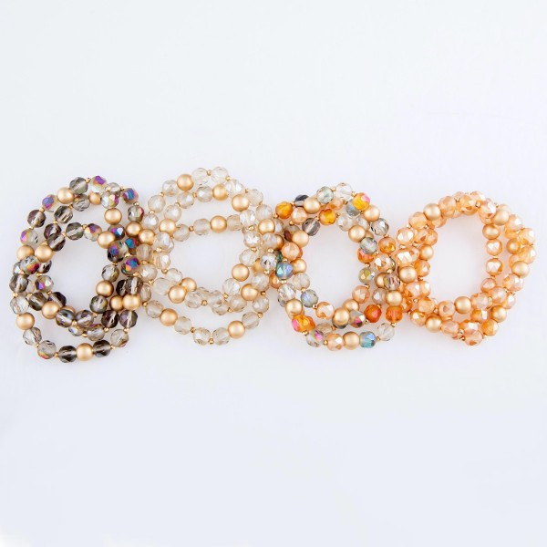 """Iridescent Faceted Beaded Stretch Bracelet in Gold.  - 3pcs per set - Approximately 3"""" in Diameter - Fits up to a 7"""" Wrist - Bead Size: 7mm"""