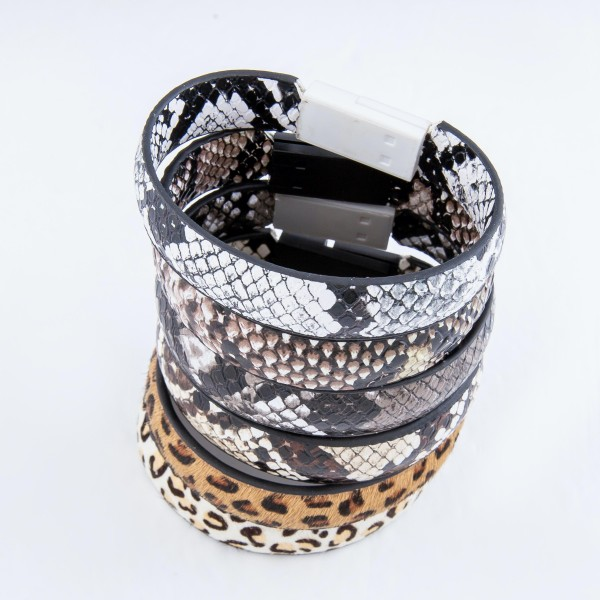 "Faux Leather Leopard Print Lightning Cable USB Charger Bracelet.  - Features: Lightning Cable USB Plug-In Closure - Approximately 3"" in Diameter - Fits up to a 6"" Wrist"