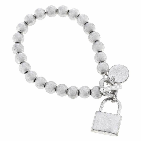 """Beaded Lock Charm Stretch Bracelet Featuring Toggle Bar.  - Lock Charm .75"""" - Toggle Bar Closure - Approximately 3"""" in Diameter - Fits up to a 7"""" Wrist"""