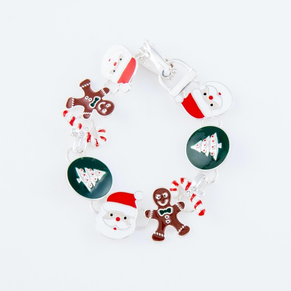"""Enamel Coated Christmas Charm Magnetic Bracelet.  - Features: Santa, Gingerbread Men, Candy Canes and Christmas Trees  - Magnetic Hook Closure - Approximately 3"""" in Diameter - Fits up to a 6"""" Wrist"""