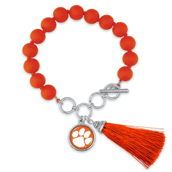 "Clemson Beaded Game Day Tassel Bracelet Featuring Adjustable Toggle Bar.  - Charm & Tassel (approx) 1"" - Bead Size: 9mm - Approximately 3"" in Diameter - Fits up to a 7"" Wrist"