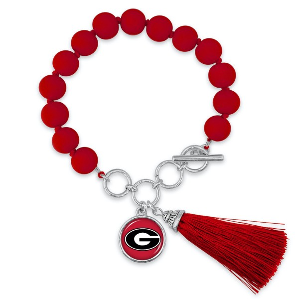 "Georgia Beaded Game Day Tassel Bracelet Featuring Adjustable Toggle Bar.  - Charm & Tassel (approx) 1"" - Bead Size: 9mm - Approximately 3"" in Diameter - Fits up to a 7"" Wrist"