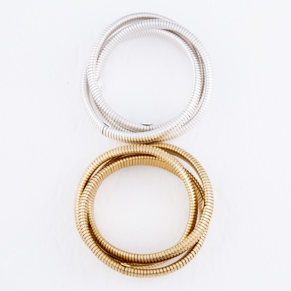 "3-Row Interlocking Tube Stretch Bangle Bracelet Set in Worn Gold.  - 3 Piece Per Set - Approximately 3"" in Diameter - Fits up to a 7"" Wrist"
