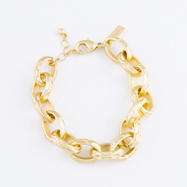 "Textured Oval Chain Link Bracelet in a Gold Finish.  - Approximately 3"" in Diameter - Fits up to a 7"" Wrist"
