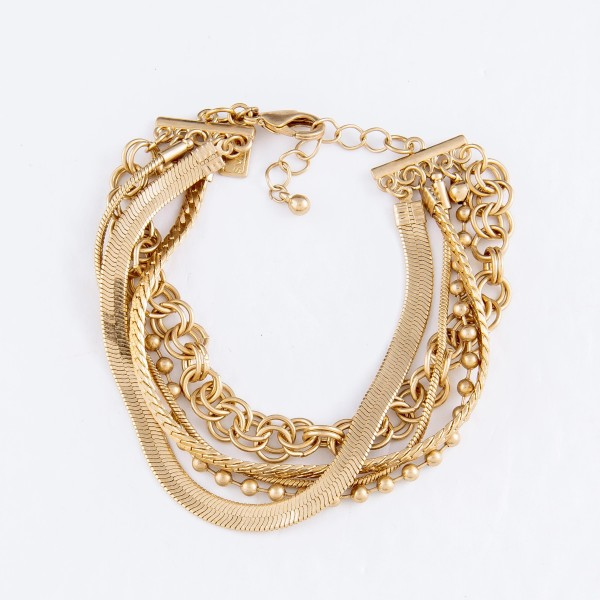 "Chain Link Layered Bracelet in Gold.  - Approximately 3"" in Diameter - Fits up to a 7"" Wrist - 1"" Adjustable Extender"
