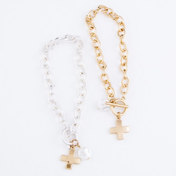 "Chain Link Ivory Pearl Cross Charm Bracelet in Gold.  - Toggle Bar Clasp Closure - Approximately 3"" in Diameter - Fits up to a 6"" Wrist"